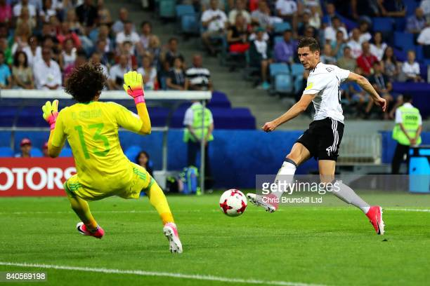 Leon Goretzka of Germany shoots past Guillermo Ochoa of Mexico to score his sides second goal during the FIFA Confederations Cup Russia 2017...