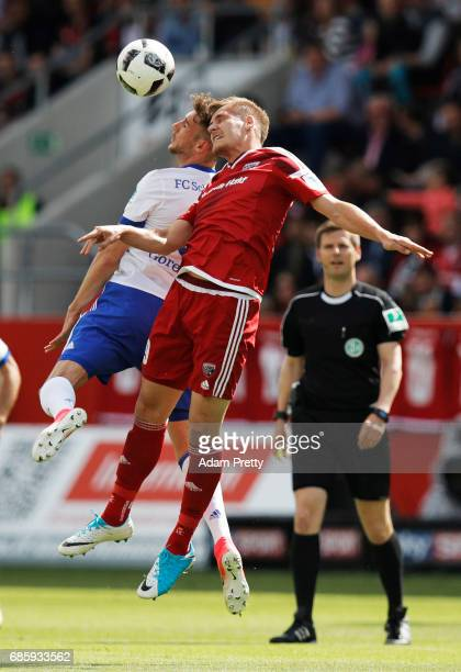 Leon Goretzka of Schalke 04 challenges Max Christiansen of Ingolstadt 04 during the Bundesliga match between FC Ingolstadt 04 and FC Schalke 04 at...