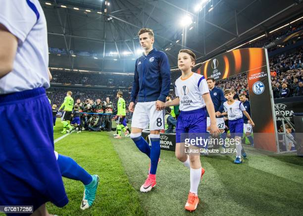 Leon Goretzka of Schalke and a boy walk on to the pitch prior to the UEFA Europa League quarter final second leg match between FC Schalke 04 and Ajax...