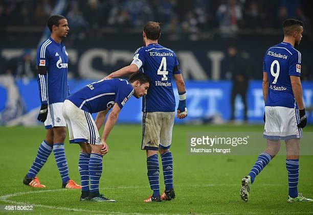 Leon Goretzka of Schalke and Benedikt Hoewedes of Schalke show their disappointment after the Bundesliga match between FC Schalke 04 and FC Bayern...
