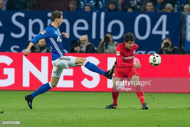 Leon Goretzka of Schalke and Jesus Vallejo of Eintracht Frankfurt battle for the ball during the Bundesliga match between FC Schalke 04 and Eintracht...