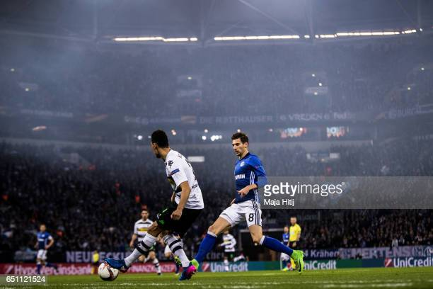Leon Goretzka of Schalke and Timothee Kolodziejczak of Moenchengladbach battle for the ball during the UEFA Europa League Round of 16 first leg match...