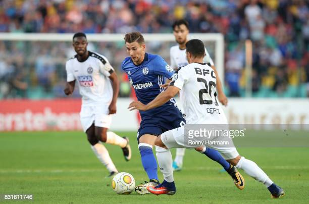 Leon Goretzka of Schalke and Ugurtan Cepni of Berlin vie during the DFB Cup first round match between BFC Dynamo and FC Schalke 04 at...