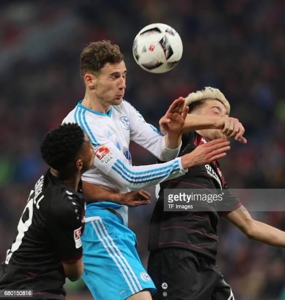 Leon Goretzka of Schalke and Wendell of Leverkusen and Kevin Kampl of Leverkusen battle for the ball during to the Bundesliga match between Bayer 04...
