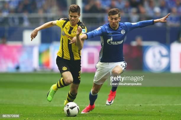Leon Goretzka of Schalke battles for the ball with Dzenis Burnic of Borussia Dortmund during the Bundesliga match between FC Schalke 04 and Borussia...