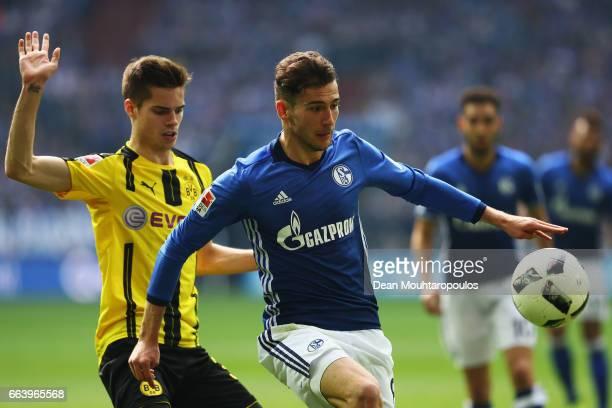 Leon Goretzka of Schalke battles for the ball with Julian Weigl of Borussia Dortmund during the Bundesliga match between FC Schalke 04 and Borussia...