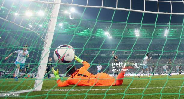 Leon Goretzka of Schalke celebrates his team's first goal past goalkeeper Yann Sommer of Moenchengladbach during the UEFA Europa League Round of 16...