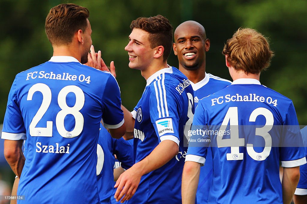 Leon Goretzka (2L) of Schalke celebrates his team's third goal with team mates <a gi-track='captionPersonalityLinkClicked' href=/galleries/search?phrase=Adam+Szalai&family=editorial&specificpeople=2344504 ng-click='$event.stopPropagation()'>Adam Szalai</a>, <a gi-track='captionPersonalityLinkClicked' href=/galleries/search?phrase=Felipe+Santana&family=editorial&specificpeople=5422021 ng-click='$event.stopPropagation()'>Felipe Santana</a> and Tim Bodenroeder (L-R) during the friendly match between FC 08 Villingen and FC Schalke 04 on July 4, 2013 in Villingen-Schwenningen, Germany.