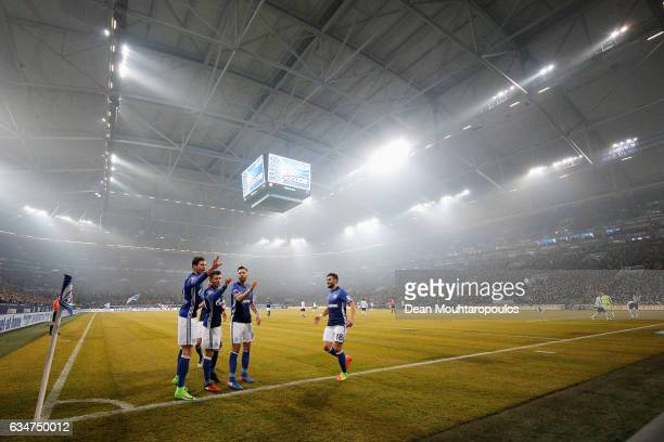 Leon Goretzka of Schalke celebrates scoring his teams second goal of the game with team mates during the Bundesliga match between FC Schalke 04 and...