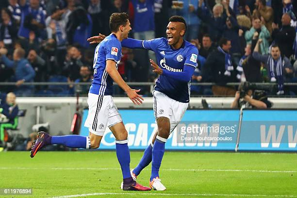 Leon Goretzka of Schalke celebrates scoring his teams third goal of the game with team mate Eric Maxim ChoupoMoting during the Bundesliga match...