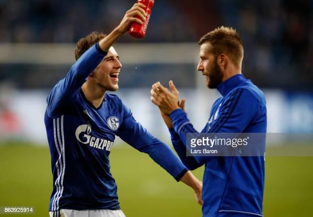 Leon Goretzka of Schalke celebrates with Guido Burgstaller of Schalke after winning the Bundesliga match between FC Schalke 04 and 1 FSV Mainz 05 at...