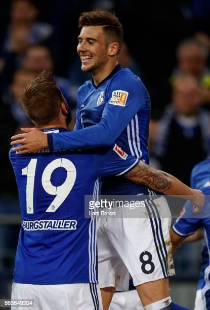 Leon Goretzka of Schalke celebrates with team mates after scoring his teams first goal during the Bundesliga match between FC Schalke 04 and 1 FSV...