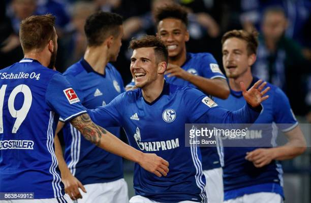 Leon Goretzka of Schalke celebrates with team mates after scoring his teams first goal during the Bundesliga match between FC Schalke 04 and 1 FSV...