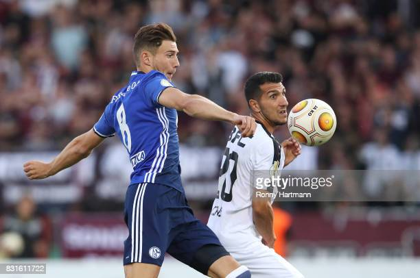 Leon Goretzka of Schalke competes with Ugurtan Cepni of Berlin vie during the DFB Cup first round match between BFC Dynamo and FC Schalke 04 at...