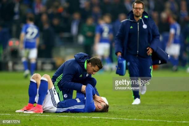 Leon Goretzka of Schalke is treated after an injury during the UEFA Europa League quarter final second leg match between FC Schalke 04 and Ajax...