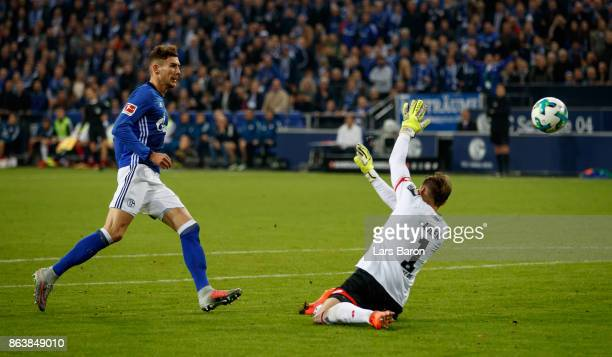 Leon Goretzka of Schalke scores his teams first goal against goalkeeper Rene Adler of Mainz during the Bundesliga match between FC Schalke 04 and 1...