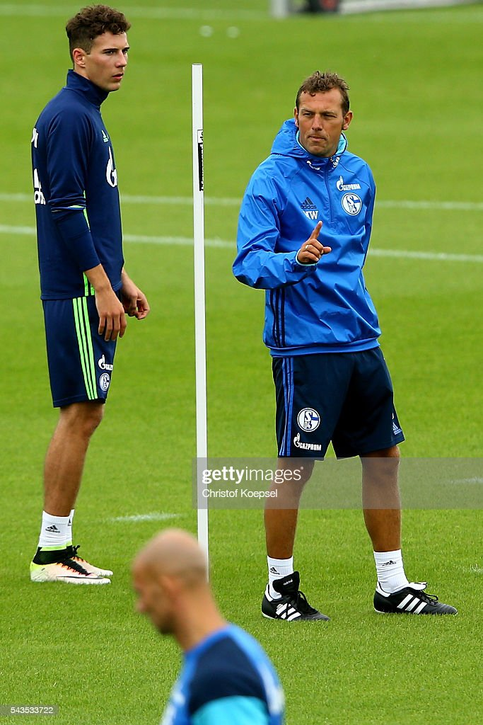 Leon Goretzka watches head coach <a gi-track='captionPersonalityLinkClicked' href=/galleries/search?phrase=Markus+Weinzierl&family=editorial&specificpeople=5848121 ng-click='$event.stopPropagation()'>Markus Weinzierl</a> during the training session of Schalke 04 at training ground on June 29, 2016 in Gelsenkirchen, Germany.