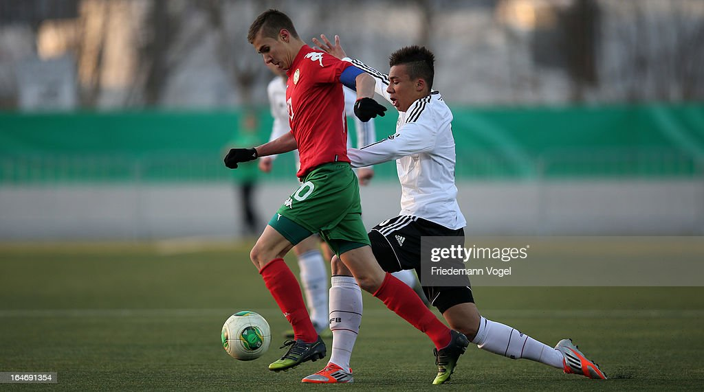 Leon Guwara (R) of Germany and Antonio Vutov (L) of Bulgaria battle for the ball during the UEFA Under17 Elite Round match between Germany and Bulgaria at Toennies-Arena on March 26, 2013 in Rheda-Wiedenbruck, Germany.