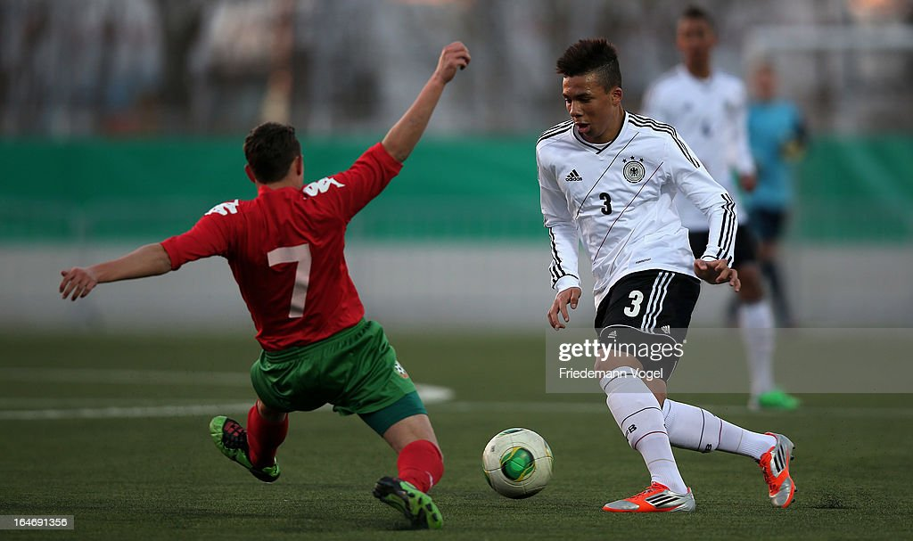 Leon Guwara (R) of Germany and Emil Dobrinov Petrov (L) of Bulgaria battle for the ball during the UEFA Under17 Elite Round match between Germany and Bulgaria at Toennies-Arena on March 26, 2013 in Rheda-Wiedenbruck, Germany.