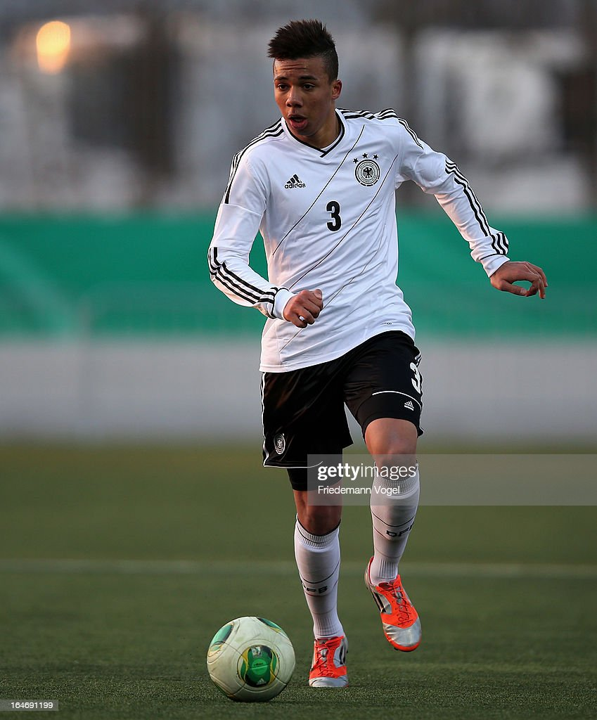 Leon Guwara of Germany runs with the ball during the UEFA Under17 Elite Round match between Germany and Bulgaria at Toennies-Arena on March 26, 2013 in Rheda-Wiedenbruck, Germany.