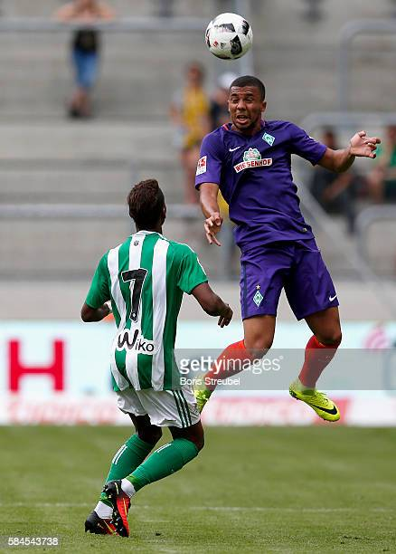 Leon Guwara of Werder Bremen jumps for a header with Charly Musonda of Real Betis during the Bundeswehr Karriere Cup Dresden 2016 match between...