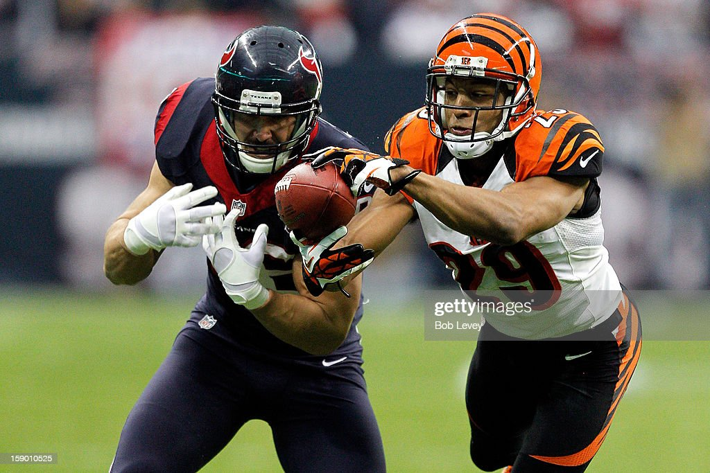 <a gi-track='captionPersonalityLinkClicked' href=/galleries/search?phrase=Leon+Hall&family=editorial&specificpeople=223989 ng-click='$event.stopPropagation()'>Leon Hall</a> #29 of the Cincinnati Bengals intercepts a pass and returns it 21-yards for a touchdown in the second quarter against James Casey #86 of the Houston Texans during their AFC Wild Card Playoff Game at Reliant Stadium on January 5, 2013 in Houston, Texas.
