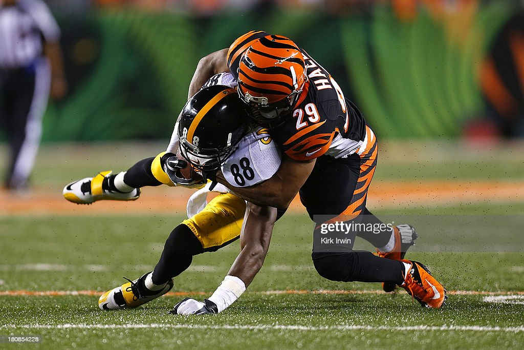 <a gi-track='captionPersonalityLinkClicked' href=/galleries/search?phrase=Leon+Hall&family=editorial&specificpeople=223989 ng-click='$event.stopPropagation()'>Leon Hall</a> #29 of the Cincinnati Bengals tackles <a gi-track='captionPersonalityLinkClicked' href=/galleries/search?phrase=Emmanuel+Sanders&family=editorial&specificpeople=5798683 ng-click='$event.stopPropagation()'>Emmanuel Sanders</a> #88 of the Pittsburgh Steelers during the fourth quarter on September 16, 2013 at Paul Brown Stadium on September 16, 2013 in Cincinnati, Ohio. Cincinnati defeated Pittsburgh 20-10.