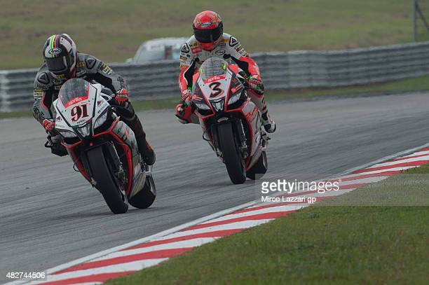 Leon Haslam of Great Britain and Aprilia Racing Team Red Devils leads Max Biaggi of Italy and APRILIA RACING TEAM RED DEVILS during the Race 1 during...