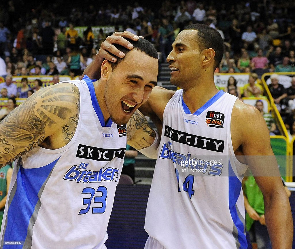 Leon Henry (L) and Mika Vukona of the Breakers celebrate after winning the round 14 NBL match between the Townsville Crocodiles and the New Zealand Breakers at Townsville Entertainment Centre on January 11, 2013 in Townsville, Australia.