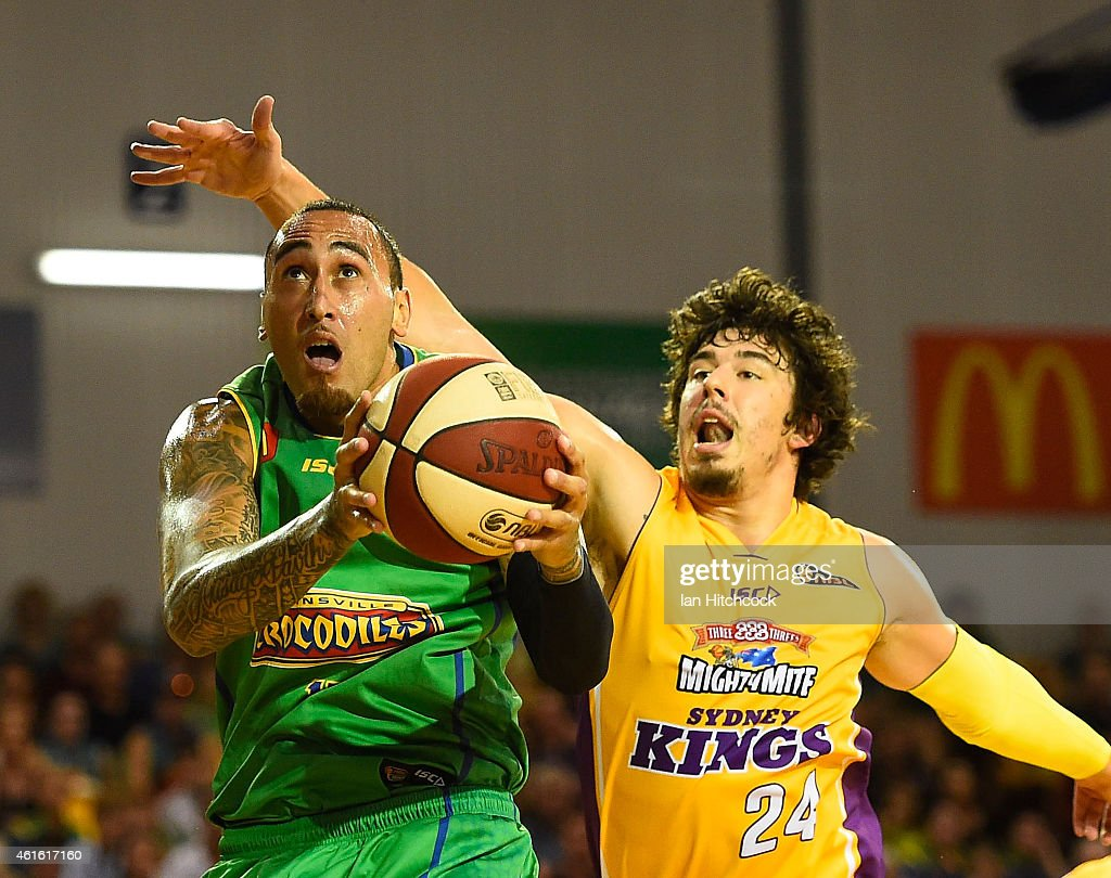 Leon Henry of the Crocodiles drives to the basket past Cody Ellis of the KIngs during the round 15 NBL match between the Townsville Crocodiles and Sydney Kings at Townsville RSL Stadium on January 16, 2015 in Townsville, Australia.