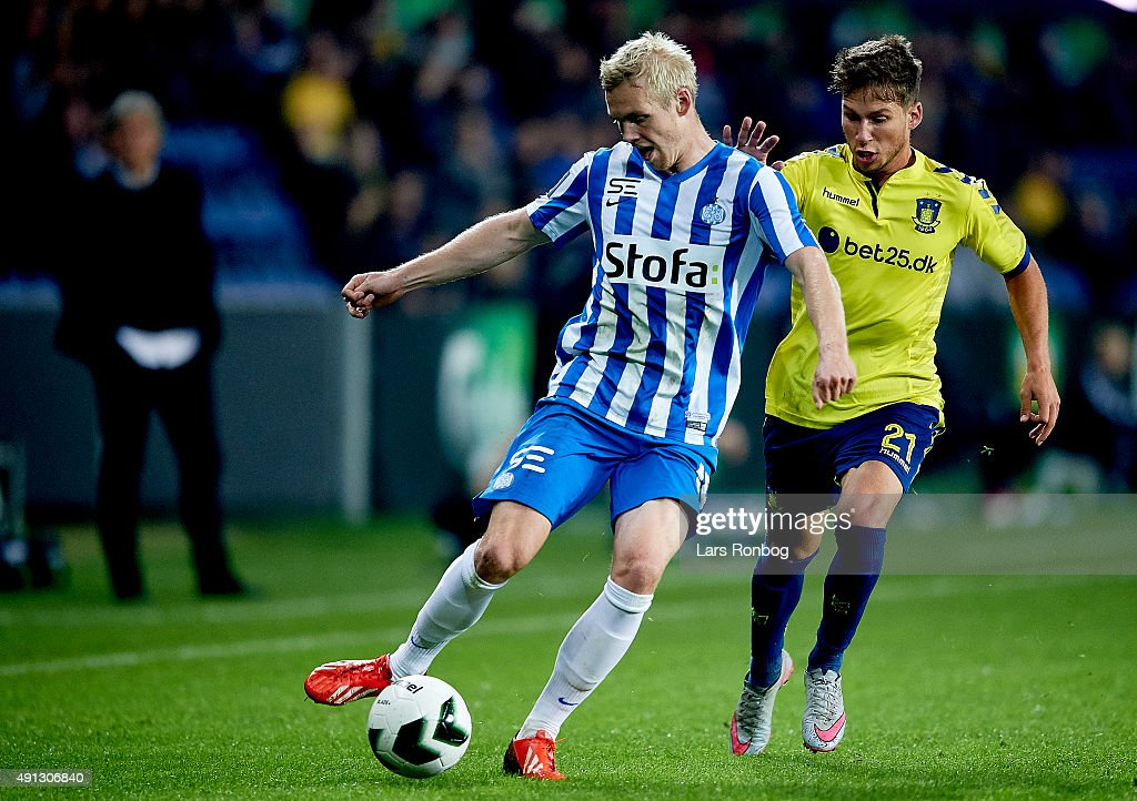 Leon Jessen of Esbjerg fB and Andrew Hjulsager of Brondby IF compete for the ball during the Danish Alka Superliga match between Brondby IF and Esbjerg fB at Brondby Stadion on October 4, 2015 in Brondby, Denmark.