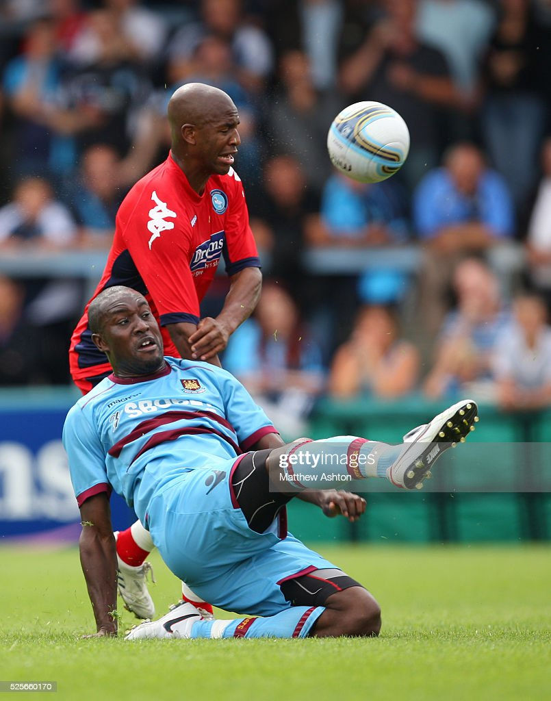 Leon Johnson of Wycombe Wanderers and Carlton Cole of West Ham United