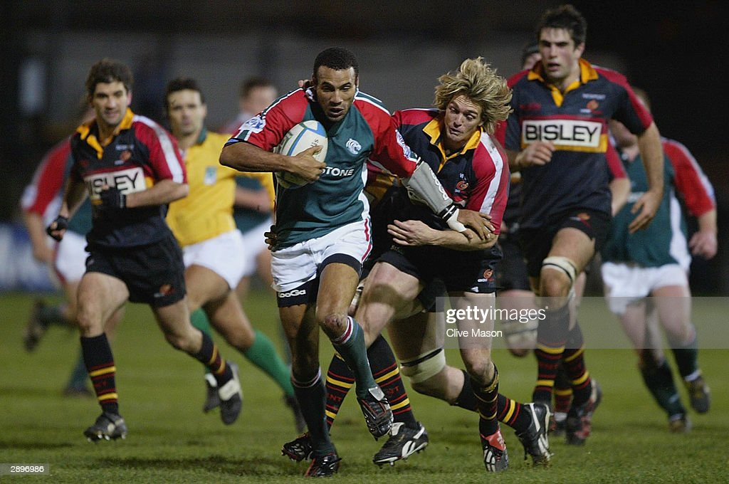 Leon Llyod of Leicester Tigers is tackled by Percy Montgomery of Gwent Dragons during the Heineken Cup match between Gwent Dragons and Leicester...
