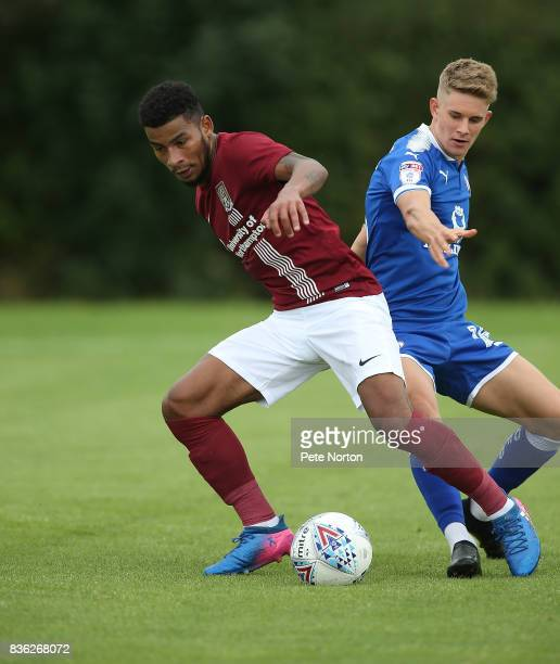Leon Lobjoit of Northampton Town looks to control the ball under pressure from Charlie Wakefield of Chesterfield during the Reserve Match between...