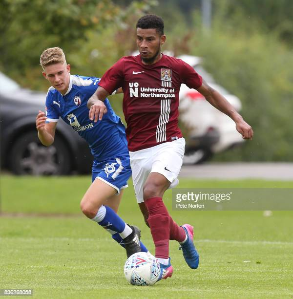 Leon Lobjoit of Northampton Town moves forward with the ball away from Charlie Wakefield of Chesterfield during the Reserve Match between Northampton...