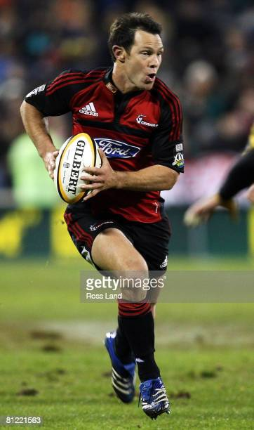 Leon MacDonald of the Crusaders runs the ball during the Super 14 semifinal match between the Crusaders and the Hurricanes at AMI Stadium on May 24...