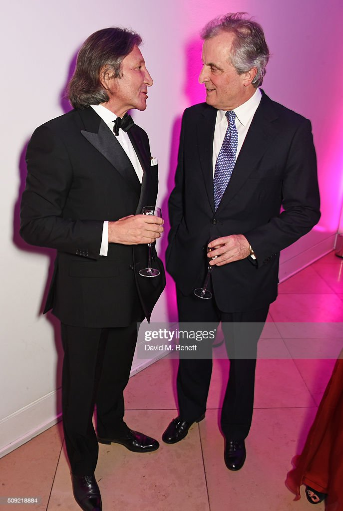 Leon Max (L) and Viscount William Astor attend a private view of 'Vogue 100: A Century of Style' hosted by Alexandra Shulman and Leon Max at the National Portrait Gallery on February 9, 2016 in London, England.