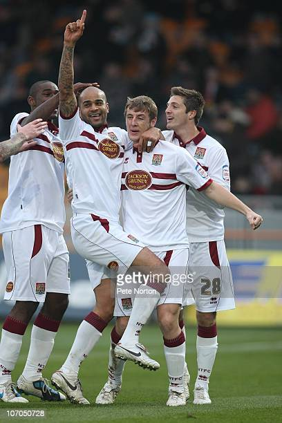 Leon McKenzie of Northampton Town celebrates after scoring his sides goal with team mates Nathaniel WedderburnJohn Johnson and Craig King during the...