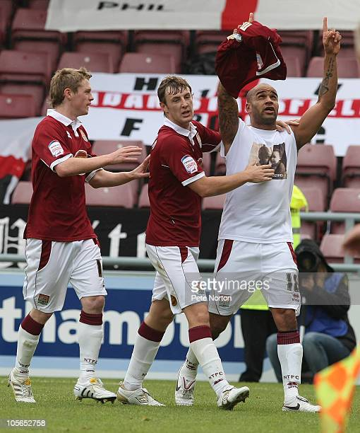 Leon McKenzie of Northampton Town is congratulated by team mates John Johnson and Billy Mckay after scoring his and his sides first goal McKenzie...