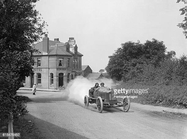 Leon Molon's Minerva passing the Ginger Hall Hotel Sulby during the RAC Isle of Man TT race 1914 Minerva 3308 cc Event Entry No 12 Driver Molon L...