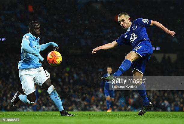 Leon Osman of Everton and Bacary Sagna of Manchester City compete for the ball during the Barclays Premier League match between Manchester City and...