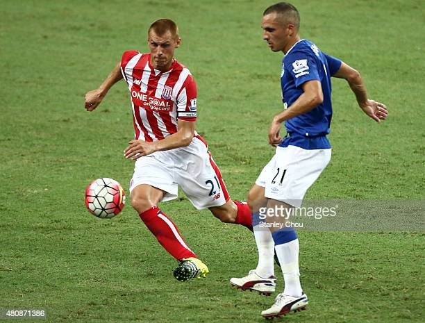 Leon Osman of Everton battles with Steven Sidwell of Stoke City during the Barclays Asia Trophy match between Everton and Stoke City at National...