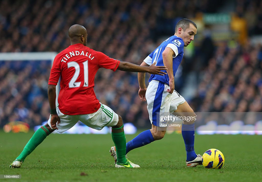 Leon Osman of Everton beats Dwight Tiendalli of Swansea City during the Barclays Premier League match between Everton and Swansea City at Goodison Park on January 12, 2013 in Liverpool, England.