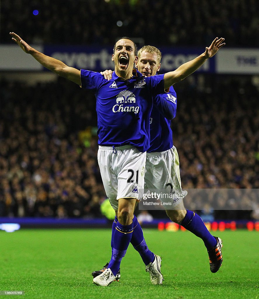Leon Osman of Everton celebrates his goal with Tony Hibbert during the Barclays Premier League match between Everton and Swansea City at Goodison Park on December 21, 2011 in Liverpool, England.