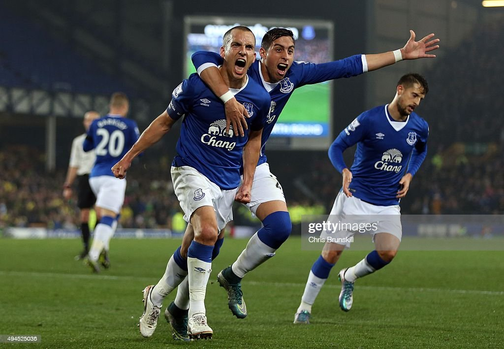 <a gi-track='captionPersonalityLinkClicked' href=/galleries/search?phrase=Leon+Osman&family=editorial&specificpeople=208939 ng-click='$event.stopPropagation()'>Leon Osman</a> of Everton celebrates scoring his side's first goal with team-mate <a gi-track='captionPersonalityLinkClicked' href=/galleries/search?phrase=Ramiro+Funes+Mori&family=editorial&specificpeople=9190139 ng-click='$event.stopPropagation()'>Ramiro Funes Mori</a> during the Capital One Cup Fourth Round match between Everton and Norwich City at Goodison Park on October 27, 2015 in Liverpool, England.