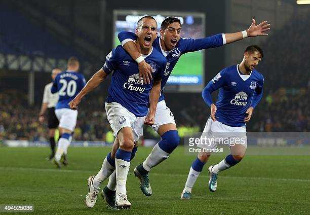 Leon Osman of Everton celebrates scoring his side's first goal with teammate Ramiro Funes Mori during the Capital One Cup Fourth Round match between...