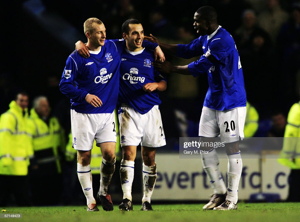Leon Osman of Everton celebrates with Tony Hibbert and Joseph Yobo during the Barclays Premiership match between Everton and Portsmouth at Goodison...