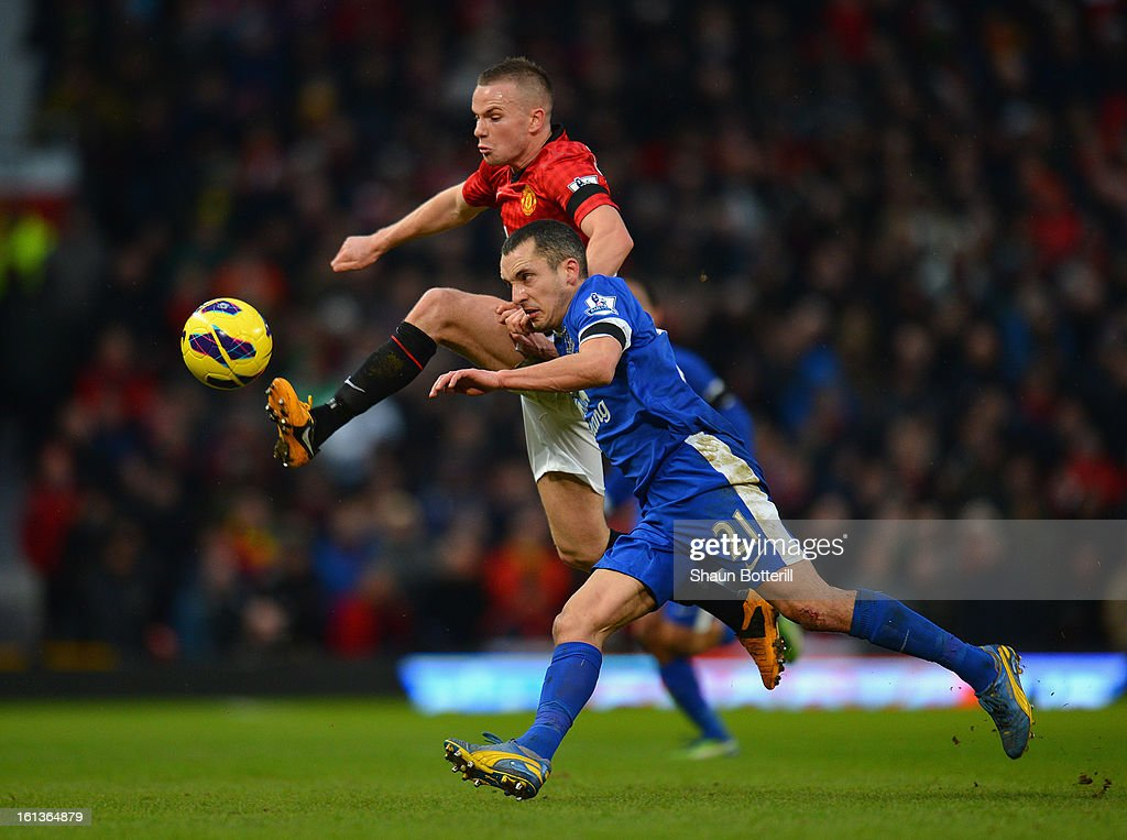 Leon Osman of Everton competes with Tom Cleverley of Manchester United during the Barclays Premier League match between Manchester United and Everton at Old Trafford on February 10, 2013 in Manchester, England.