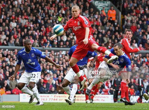 Leon Osman of Everton directs a header on goal as Martin Skrtel of Liverpool attempts to block during the Barclays Premier League match between...