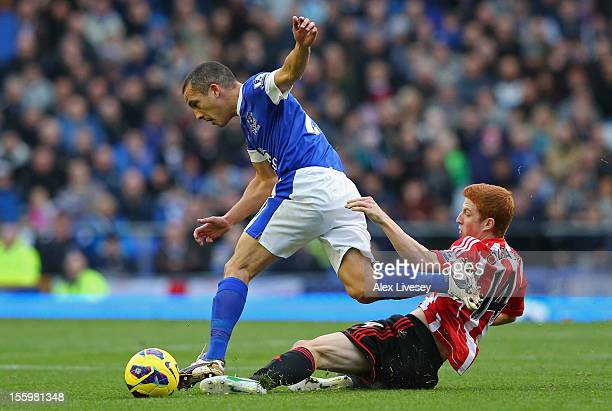 Leon Osman of Everton is tackled by Jack Colback of Sunderland during the Barclays Premier League match between Everton and Sunderland at Goodison...